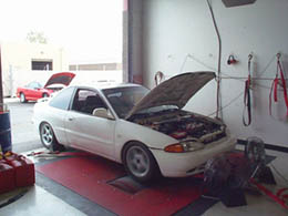 White 1995 Mirage LS on the dyno